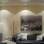 Wohnzimmer mit DIPline und mikroperforierter Spanndecke für gute Akustik
